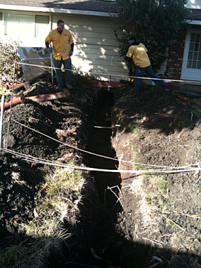 Tracy plumbers install a sewer line